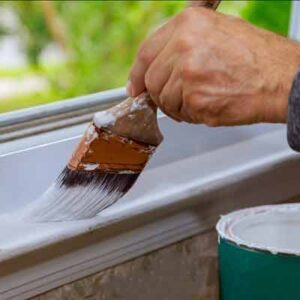 painter painting window moulding