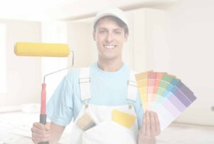 painter holding paint roller and color swabs at residential jobsite