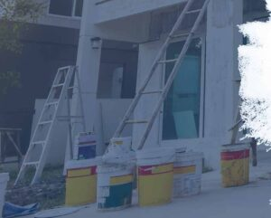 paint buckets and ladder at jobsite